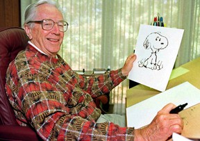 """Cartoonist Charles Schulz displays a sketch of his beloved character """"Snoopy"""" in his office in Santa Rosa, Calif. in this 1997 photo.The Peanuts gang of cartoon characters created by Charles Schulz is getting a new home at a Halifax-based entertainment company under a US$345-million deal announced Wednesday. THE CANADIAN PRESS/AP Ben Margot)"""