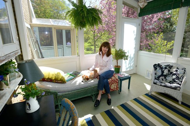 Susan Jory in her porch at her home on Wilson Street in London. (MORRIS LAMONT, The London Free Press)