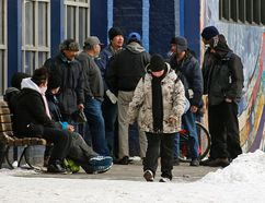 POSTMEDIA NETWORK - People gather outside the Boyle Street Community Services building in downtown last March.