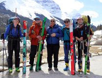 Chic Scott, centre, celebrates with Grand Traverse conquerers, left to right, Lynnea Baker, of Revelstoke, Eliot Brooks, of Revelstoke, Daren Farley, of Canmore, and Alex Heathcott, of Calgary, at The Great Divide hotel parking lot in Banff National Park on May 2 after a 21-day ski journey that began near Jasper. Scott was a member of the first group to cover the same route in 1967.
