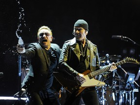 """U2 live in concert kicked off their """"Innocence & Experience"""" tour in Rogers arena in Vancouver on May 14, 2015. The iconic Irish rock band will be back in Vancouver on May 12, 2017 to launch of the 30th anniversary """"Joshua Tree"""" tour. (Mark van Manen/Postmedia Network)"""