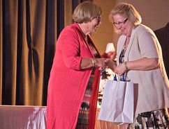 PRSD Board Trustee Louise Woroniuk exchanges a laugh with Nampa Public School office manager Ethyl Velie, who was recognized for her 15 years with the division at the Awards Gala on Friday May 5 in Peace River.