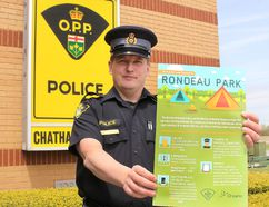 Chatham-Kent OPP Const. Jay Denorer is pictured with a poster that has been placed in area high schools outlining the rules and consequences of breaking those rules to local young people planning on camping at Rondeau Provincial Park during the upcoming Victoria Day long weekend. Photo taken in Chatham, Ont. on Wednesday May 10, 2017. (Ellwood Shreve/Chatham Daily News)