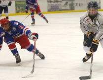 Kaden Reinders, right, of the Grande Prairie Bantam AAA Storm, tries to get around Tyson Weber, of the Fort Saskatchewan Bantam AAA Rangers on Saturday October 1, 2016 at the Crosslink County Sportsplex north of Grande Prairie.