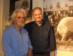 David Suzuki and Mike Baker, Elgin County Museum curator, stand beside an enlarged photo of Jumbo in the museum's exhibit on the legendary elephant. Suzuki was in town on Wednesday to film part of his show The Nature of Things, which will feature the history of Jumbo. Laura Broadley/Times-Journal
