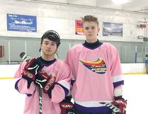 Kaiden Guhle, right, with OHA teammate Peyton McKenzie. Photo supplied