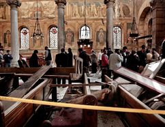 In this Sunday, Dec. 11, 2016, file photo, security forces examine the scene inside the St. Mark Cathedral in central Cairo, following a bombing. Pope Francis meets Friday, April 28, 2017 with the leader of Egypt's Coptic Orthodox Church, part of a two-day trip to the Arab world's most populous country that comes as Islamic State group militants have been increasingly targeting its Christian minority. (AP Photo/Nariman El-Mofty