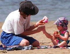 Spreading sunblock on the skin of children who are playing outside can decrease their risk of skin cancer later in life. (Postmedia Network file photo)