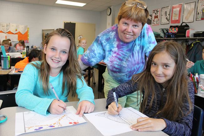 Errol Village teacher Alison Feniak is pictured here with Grade 4 students Carly Jewell and Carley General in her classroom Friday. Feniak has been named Energy Educator of the Year -- a Canada-wide honour -- for her ongoing commitment to environmental education. (Barbara Simpson/Sarnia Observer)