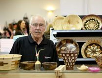 Charlie Willetts shows off his woodturner pieces at the Crossfield Farmers Market on April 22, 2017.