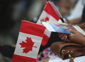 New Canadians were sworn in at Pearson International Airport just outside Toronto by Citizenship Judge Harry Dhaliwal on June 30, 2014. (Jack Boland/Postmedia Network/Files)
