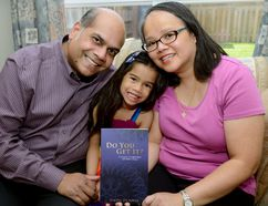 Lin-Pei De Souza, with daughter Genevieve and husband Ivan, wrote a book about her experience battling cancer while giving birth to her daughter. (MORRIS LAMONT, The London Free Press)