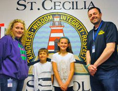 The staff and students at St. Cecilia School in Port Dover recently donated $500 in proceeds from their Mission Day carnival to the family of Olivia Hazen. Olivia is a Lynndale Heights student currently battling a form of leukemia. Mission Day organizer Tammy Caruso, left, and St. Cecilia School principal Bill Acres gather alongside friends of Olivia, students Hudson Pasichnyk and Julia Fish. JACOB ROBINSON/Simcoe Reformer