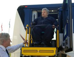 Peter Zein boards Cherrey Bus Lines Inc.'s new accessible bus on Saturday, May 13, 2017 in Stratford, Ont. Zein was able to go on the annual Toronto Blue Jays trip organized by the city because the bus line purchased a new accessible bus. Handout/Beacon Herald/Postmedia Network