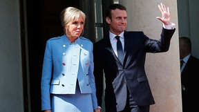 Emmanuel Macron waves as he poses for photographers with his wife Brigitte Macron after the handover ceremony with outgoing president Francois Hollande, at the Elysee Palace in Paris, France, Sunday, May 14, 2017. (AP Photo/Christophe Ena)