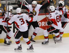 Senators' Bobby Ryan (centre) celebrates with teammates Marc Methot (3), Derick Brassard (19), Mark Stone (61) and Jean-Gabriel Pageau (44) after scoring the game-winning goal against the Penguins during the first overtime period of Game 1 of the NHL's Eastern Conference final in Pittsburgh on Saturday, May 13, 2017. (AP Photo/Gene J. Puskar)