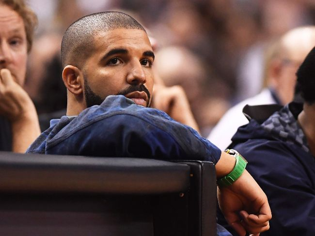 Rapper, Drake, watches the action between the Toronto Raptors and the Cleveland Cavaliers during the second half of game three of an NBA playoff series basketball game in Toronto on Friday, May 5, 2017. THE CANADIAN PRESS/Frank Gunn