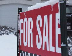 DHT FILE PHOTO A for sale sign sits in front of a home in the Wedgewood neighbourhood earlier this year. Housing sales so far this year are one of several indicators that he economy is beginning to pick back up.