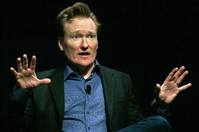 In this Feb. 12, 2016 file photo television host Conan O'Brien gestures to the audience at Sanders Theatre on the campus of Harvard University in Cambridge. O'Brien is vigorously defending himself from plagiarism allegations by a writer who accused him of ripping off punchlines about Caitlyn Jenner, Tom Brady and the Washington Monument. (AP Photo/Charles Krupa,File)