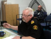 Lac Ste. Anne County Fire Chief Randy Schroeder presents a report about a fire in Silver Sands during a county council meeting on May 11. The report details how Onoway Regional Fire Services, who managed the fire, waited 39 minutes to call for mutual aid from Lac Ste. Anne County despite calling for mutual aid from other municipalities much sooner (Joseph Quigley | Mayerthorpe Freelancer)