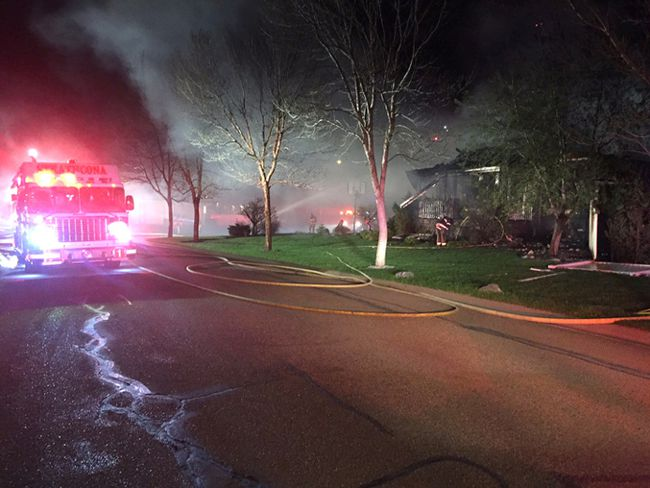 Fire crews with Strathcona County Emergency Services work to extinguish the flames at an Estates home in Sherwood Park, resulting in more than $1 million in damages.