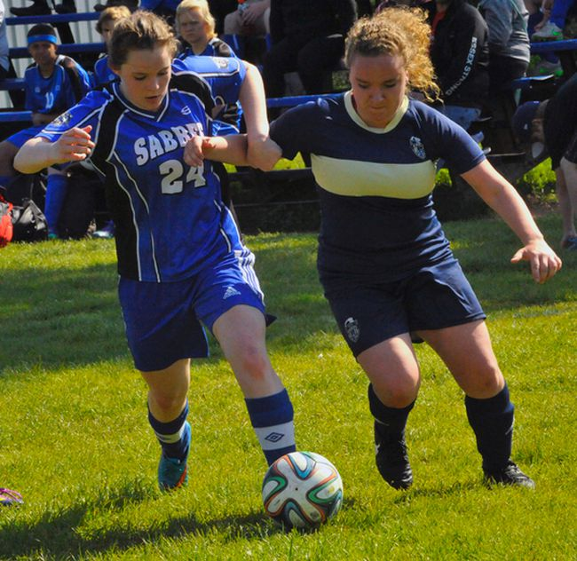 Simcoe's Hanna Patrick battles for position with Shannon Hill of Delhi during the NSSAA girls soccer semi-final at SCS on Tuesday. Patrick scored twice to help Simcoe earn a 4-1 victory.