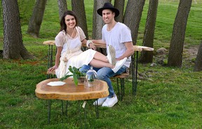 Jennifer and Jesse Lofthouse with tables they make from trees for Homes story. (MORRIS LAMONT, The London Free Press)
