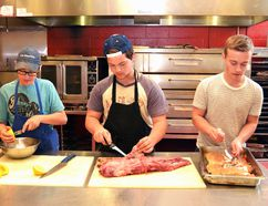 In preparation for Stratford Northwestern Secondary School's Canada 150 Culinary Adventure Thursday evening, Stuart Mikel (left) juiced some lemons, Caelen Eveleigh prepped the beef tenderloin, and Ethan Elliott flaked some hot smoked salmon. (Galen Simmons/The Beacon Herald/Postmedia Netowrk)