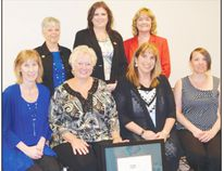 Receiving their 'long-term care best practice spotlight organization' designation, in the back row are Carol Holmes, RN, MN, GNC(C) – Program Manager, LTC Best Practices Program, RNAO, Dr. Valerie Grdisa Director of RNAO's best practice guidelines program, Heather McConnell, RN, BScN, MA(Ed) – Associate Director, IABPG Centre, RNAO. In the front are Tina Jenkins, Director of Parkview Manor, Carole Woods, Administrator Parkview Manor, Sue Sweeney- LTC Co-ordinator Southwest LHIN and BPSO Coach and Teresa Tibbo- RPN/Quality Co-ordinator and Staff Educator.