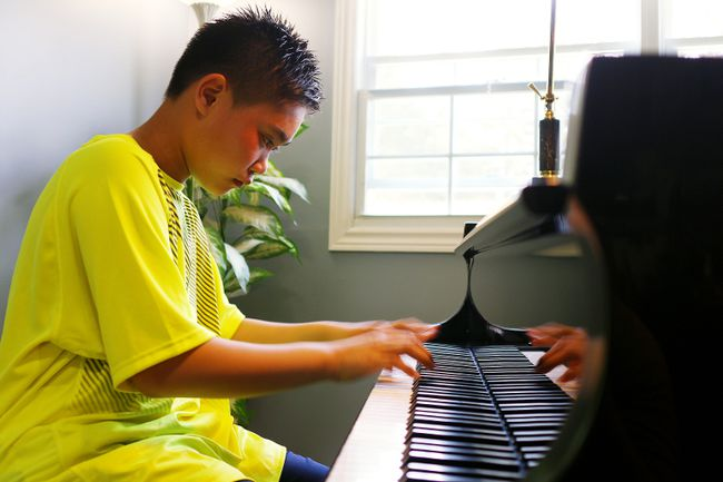 12-year-old pianist Gavin Nguyen strikes the keys of a piano, performing Toccata by David L. McIntyre, the song that he played to win the Rose Bowl at the Rotary Music Festival in Woodstock. (BRUCE CHESSELL/Sentinel-Review)