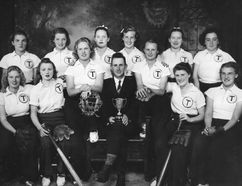 PHOTO COURTESY OF ELEANOR HARRISON Twilight Ladies' Softball Team 1940 (subsequent married names, where known, in brackets): Front row: Shirley Wheeler, Ann Sych, Emily Marek (LaValley), Gerald Carveth, manager (with Reynolds Cup), Betty Carveth (Dunn), Helen Murray, Pollyanna Johnston; Back row: Ruth Swanson, Norma Innes, Eleanor Oatway (Harrison), Edna Carveth (Jolly), Helen Oatway (Watson), Elva Evans. Eleanor Harrison and the Carveth sisters are still alive.