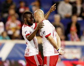 New York's Kemar Lawrence (left) and Aurelien Collin have a chat earlier this season. (GETTY IMAGES)