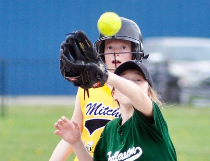 Ava Bree of the Fullarton Squirts reaches for the ball as Mitchell's Ashtyn Wedow sneaks into third base during Huron-Perth action last Wednesday, May 17 at Keterson Park. Fullarton defeated their hosts 15-10. ANDY BADER/MITCHELL ADVOCATE