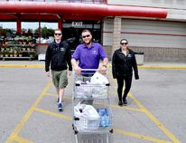 Ben Fraraccio, owner of Grocery Guy (centre), and employees Beau Sexton (left) and Brittney Yeomans are expanding the London-based small business to nearby Kitchener-Waterloo. CHRIS MONTANINI\LONDONER\POSTMEDIA NETWORK