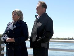 Ontario NDP Leader Andrea Horwath and byelection candidate Joe Krmpotich speak with a reporter at a media event on St. Mary's River Drive on Friday.