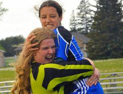 Simcoe's Ronnie Samborski and Michelle Goble are all smiles following the Sabres 3-1 overtime victory against Holy Trinity in Friday's NSSAA girls soccer final. Goble scored the game winner in overtime. JACOB ROBINSON/Simcoe Reformer