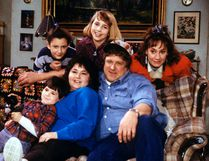 "In this undated image released by ABC, shows the cast members of ""Roseanne,"" Michael Fishman as DJ Conner, seated from left, Roseanne Barr as Roseanne Barr, John Goodman as Dan Conner, and second row from left, Sara Gilbert as Darlene Conner, Alicia Goranson as Becky Conner and Laurie Metcalf as Jackie Harris. The original cast of ""Roseanne"" will return to ABC two decades after it wrapped its hit series, the network said Tuesday in announcing its 2017-18 season plans. (Dan Watson/ABC via AP)"