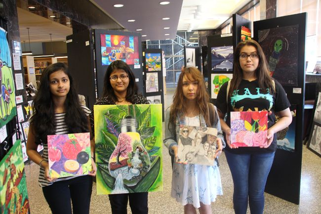 <p>Cornwall Collegiate and Vocational School students Veisnavie Uthayakumar, left, Ragavie Uthayakumar, Camaron Loran, and Nakia Thomas hold up their artwork on Thursday, May 18, 2017, which will be on display in an art show at the Cornwall Public Library until June 8. </p><p>