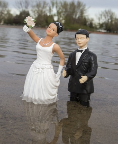 Weddings are being cancelled because of the flood waters in Toronto on Friday May 19, 2017. (Craig Robertson/Toronto Sun)