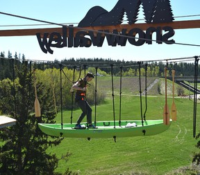 Reporter Scott Leitch trying his skills on the new Snow Valley Aerial Park attraction in Edmonton, May 19, 2017. Ed Kaiser / Postmedia