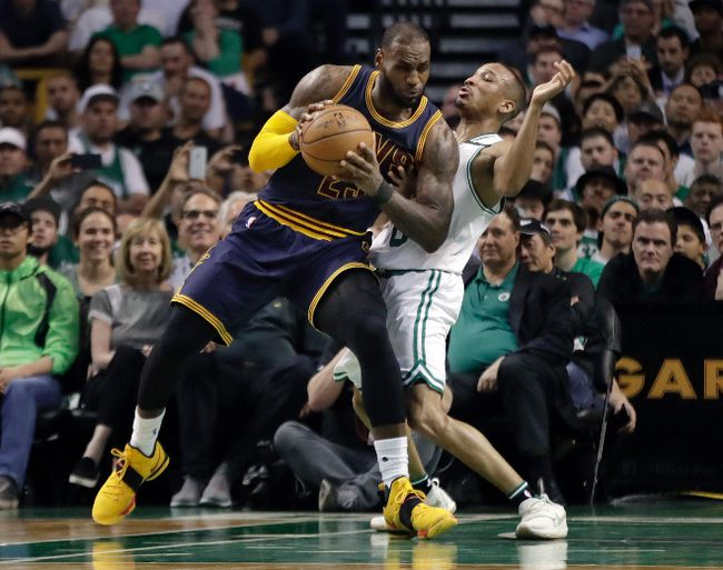 Cleveland Cavaliers forward LeBron James, left, muscles his way to the basket as Boston Celtics guard Avery Bradley, right, tries to defend during first half of Game 2 of the NBA basketball Eastern Conference finals, Friday, May 19, 2017, in Boston. (AP Photo/Elise Amendola)