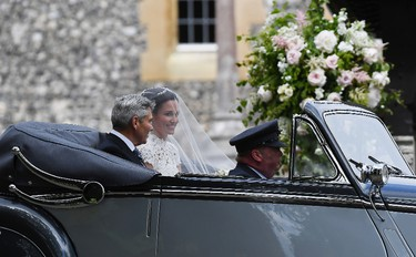 Pippa Middleton arrives with her father Michael Middleton in a 1951 Jaguar Mk V car, for her wedding ceremony at St. Mark's Church as the bridesmaids and pageboys walk ahead on May 20, 2017 in Englefield Green, England.  (Justin Tallis - WPA Pool/Getty Images)