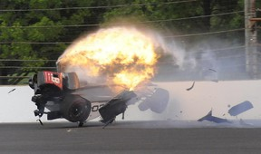 The car driven by Sebastien Bourdais hits the wall and bursts into flames in the second turn during Indianapolis 500 qualifying at Indianapolis Motor Speedway on Saturday, May 20, 2017. (Greg Huey/AP Photo)