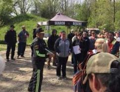 Capt. William Bolton, of Advanced Tactical Training Search and Rescue (centre) instructs more than 50 people in Brant Park Conservation Area who joined a public search Saturday for missing Brantford man Andrew Osborne. (Michael-Allan Marion/The Expositor)