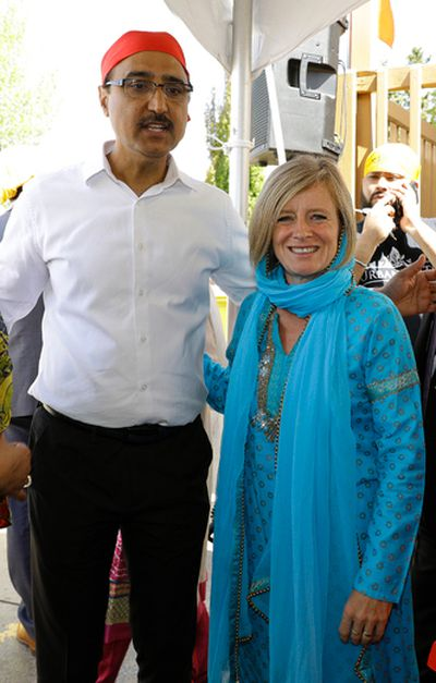 Amarjeet Sohi (left, Member of Parliament, Edmonton Millwoods) and Alberta Premier Rachel Notley (right) attended a parade and celebration of Vaisakhi Day in Edmonton's Millwoods community on Sunday May 21, 2017. Vaisakhi, a historical and religious festival in Sikhism and Hinduism, marks the Sikh and Hindu new year. An estimated ten thousand people attended the Edmonton event. (PHOTO BY LARRY WONG/POSTMEDIA)