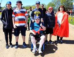 Sean Chase/Daily Observer Colby Audette (centre) is joined by some of his friends and his mother, Gloria Audette, as the fifth annual Colby's Crusade gets underway at Pembroke's Riverside Park on Saturday.