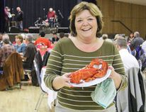 STEVE SUCHA POSTMEDIA NETWORK. Boys and Girls Clubs of the Foothills will host their annual major fundraiser in High River this year. Shirley Puttock, executive director, holds up a sampling of the evening's main dish at the 2015 Newfie Night in Nanton, Alta.