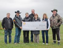 L to R: MD Councillor Terry Yagos, Kathy Rast, Kyle Rast, Tanya Douglas, Karina Cail and Dennis Olson were presented a generous donation of $7,000 from Shell Waterton Complex and community liaison Rod Sinclair, second from left, to go towards funding the revitalization of Patton Park. | Caitlin Clow photo/Pincher Creek Echo