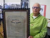Robert H. Laning, 90, holds a graduation diploma earned in 1903 by his father Robert C. Laning, which the son provided in a decade room display at the Waterford District High School 125th anniversary reunion on Sunday. (Michael-Allan Marion/The Expositor)