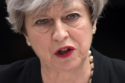 LONDON, ENGLAND - MAY 23: Britain's Prime Minister Theresa May addresses the media as she makes a statement in Downing Street following a COBRA meeting to discuss the government's response to the Manchester terror attack, on May 23, 2017 in London, England. Prime Minister Theresa May has held a COBRA meeting this morning following a suicide attack at Manchester Arena as concert goers were leaving the venue after Ariana Grande had performed. Greater Manchester Police have confirmed the explosion as a terrorist attack with 22 fatalities and 59 injured. (Photo by Carl Court/Getty Images)